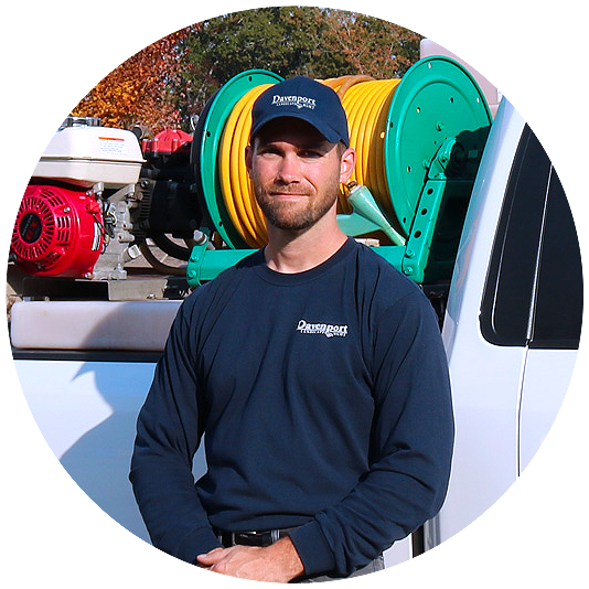 Philip Davenport standing in front of company truck